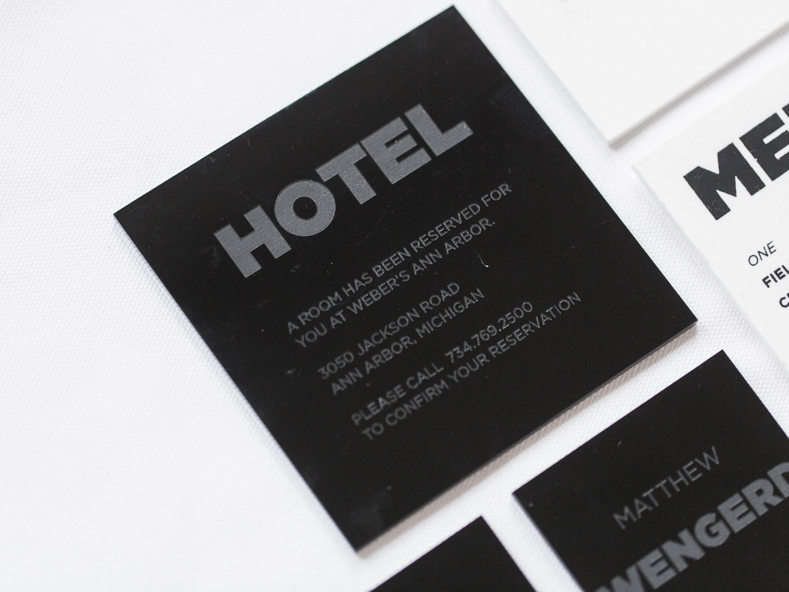 Accommodations details delivered in black acrylic